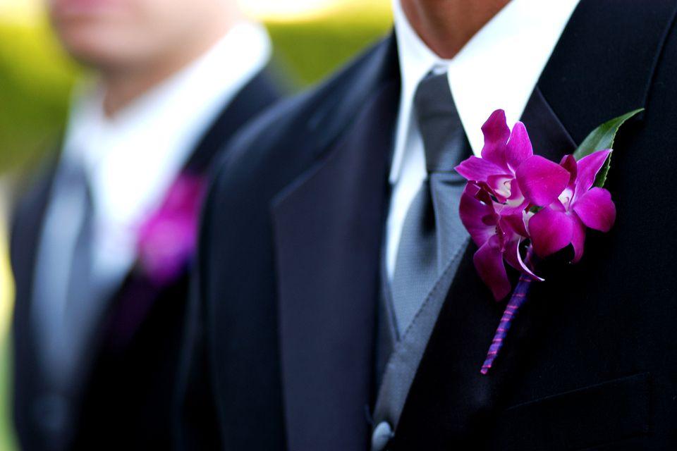 Groomsmen wearing orchid boutonniere
