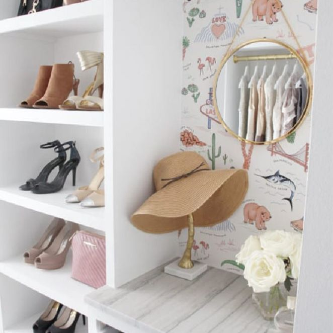 A fun open closet with a hat stand.