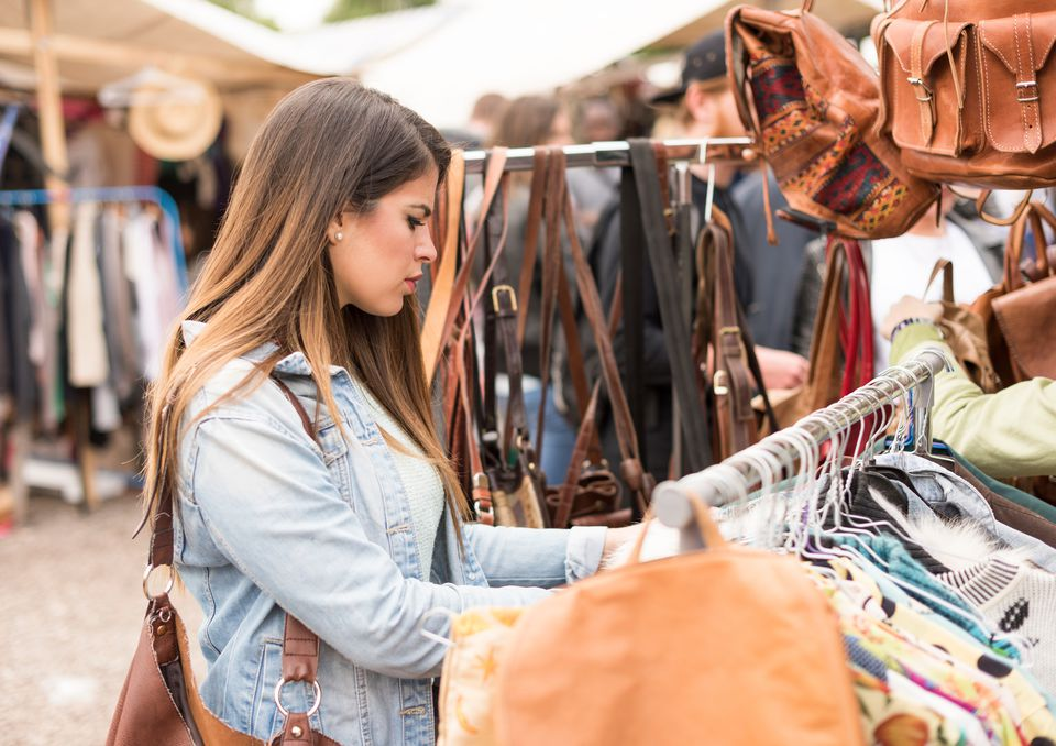 A young woman shopping in a flea market