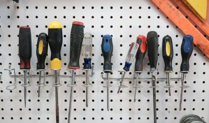 tools hung on a pegboard in garage workshop