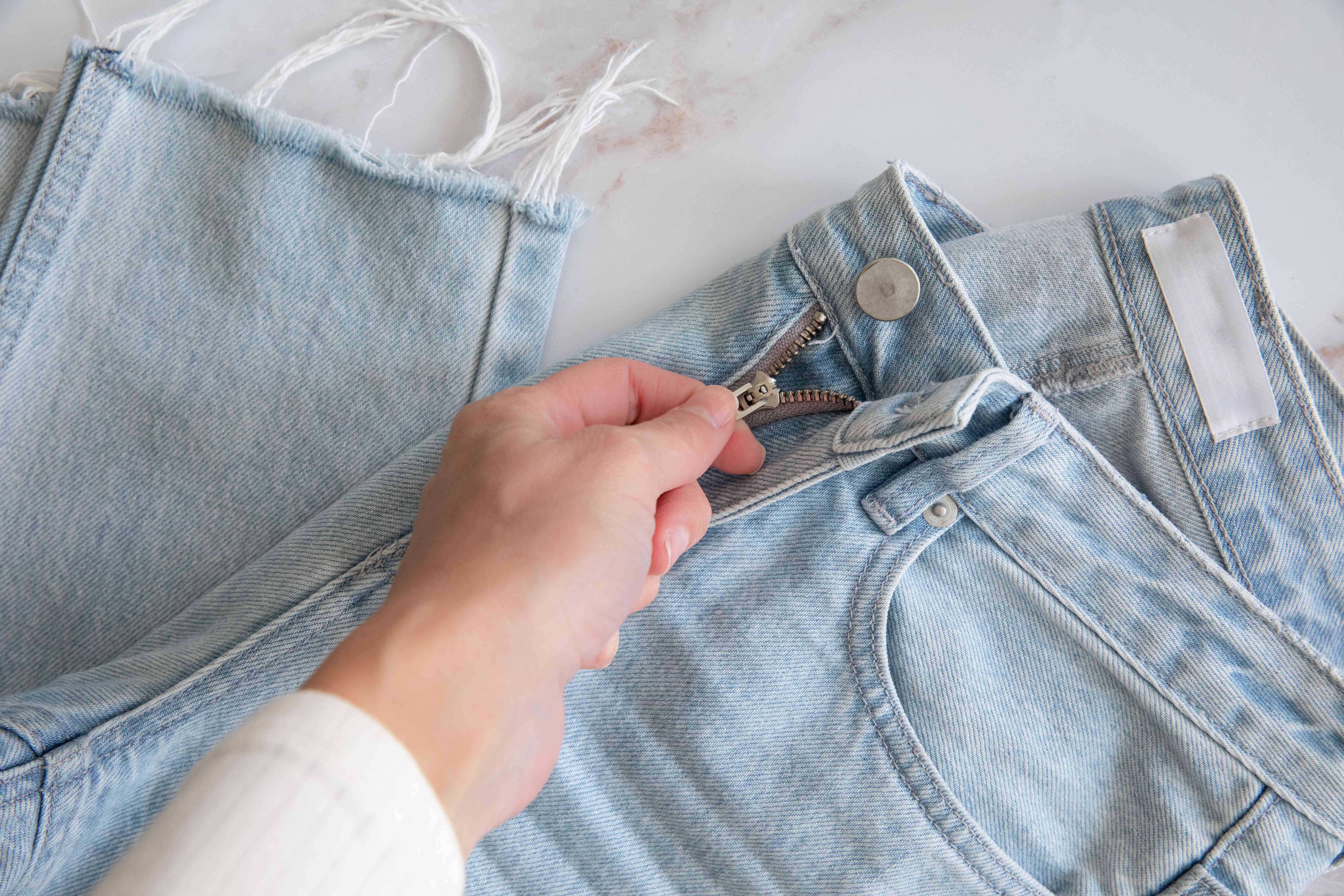 Jeans zipped up to prevent snagging clothes