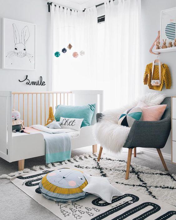 Modern, Scandinavian nursery with pastel accents