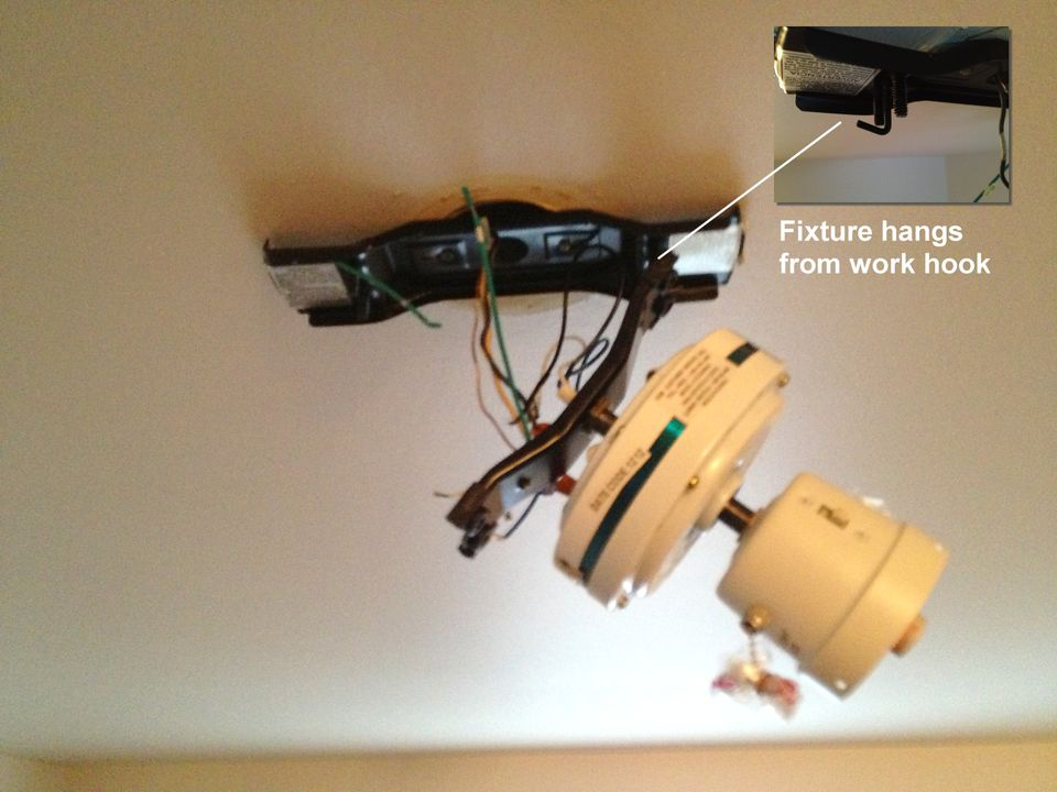 How to easily install a ceiling fan ceiling fan hooked to bracket aloadofball Choice Image