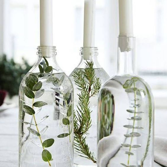 Greenery in water with candles