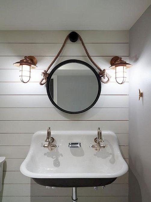 iluminación de inspiración náutica en el baño