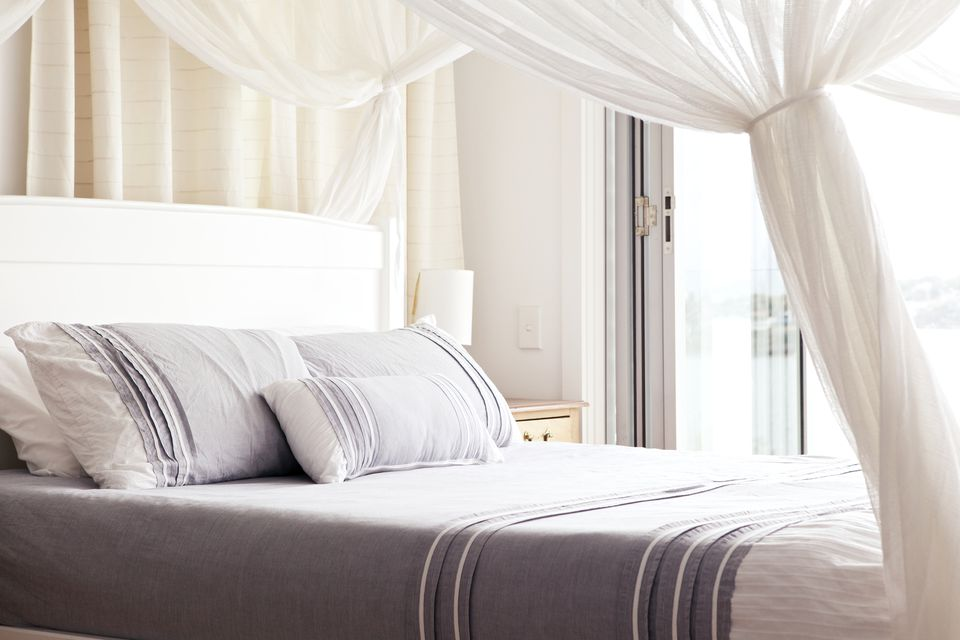a bed with luxurious linens