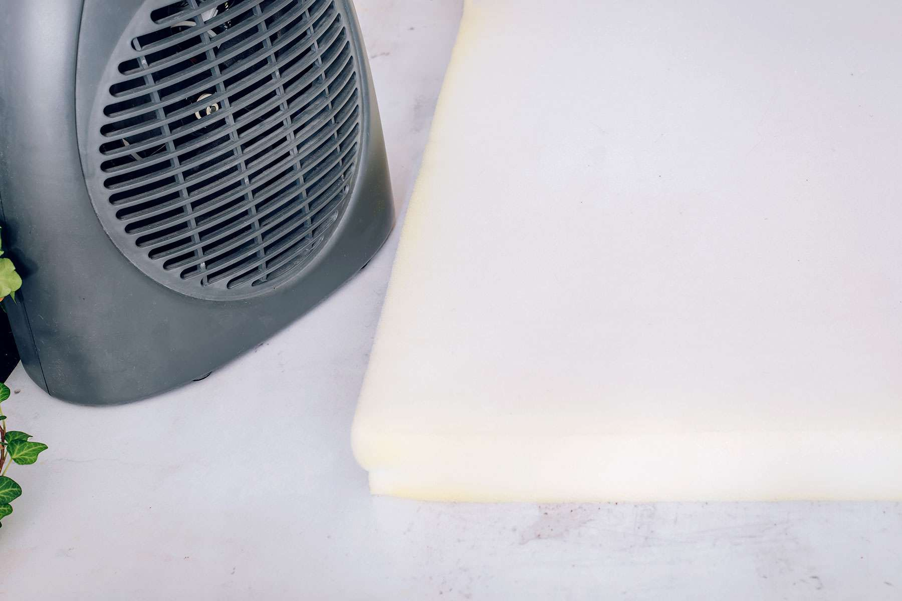 Foam mattress pad air dried with gray fan