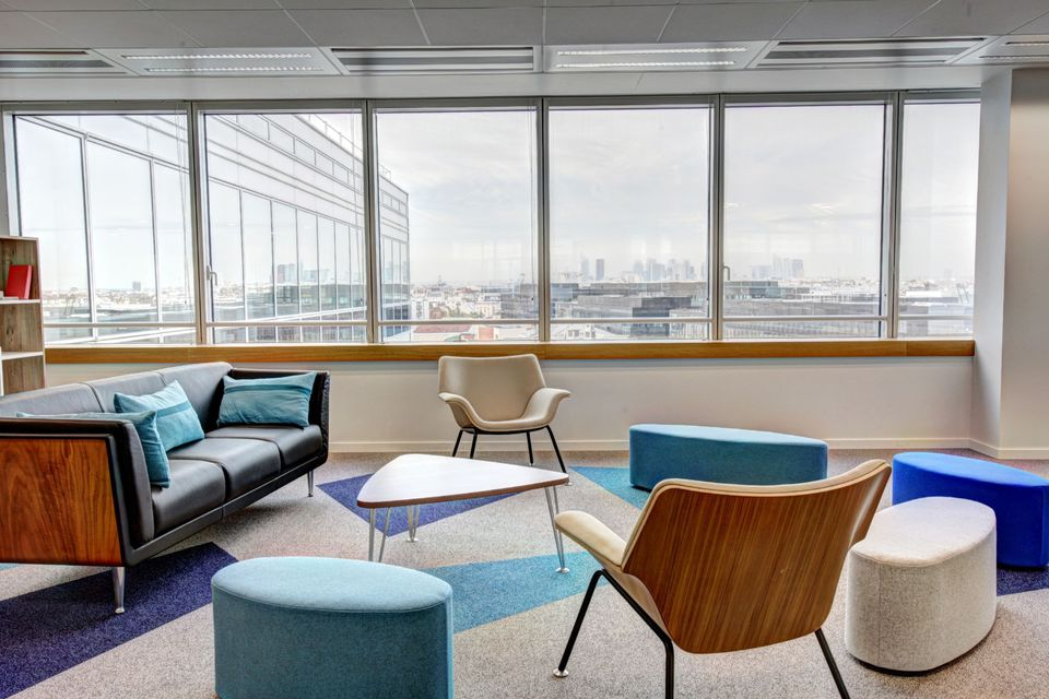 colorful office reception with sofa and chairs