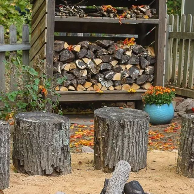 An open shed with firewood in it