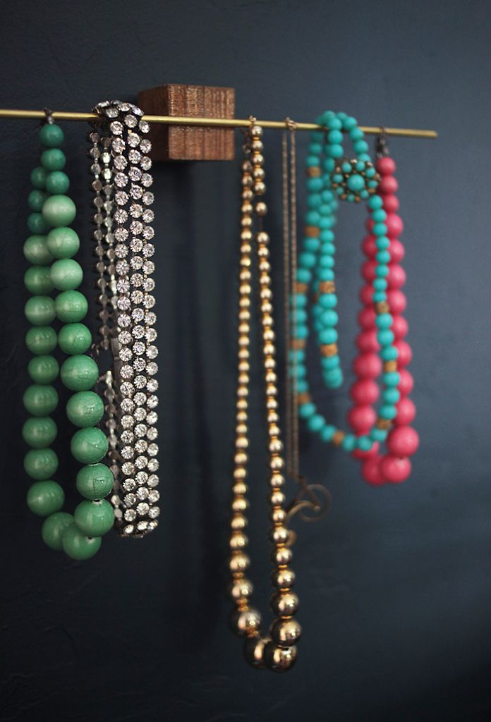 Necklaces hanging on a thin golden rod