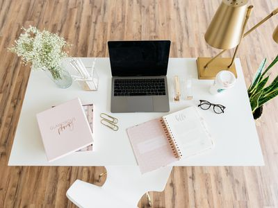 white desk with pin and gold accents