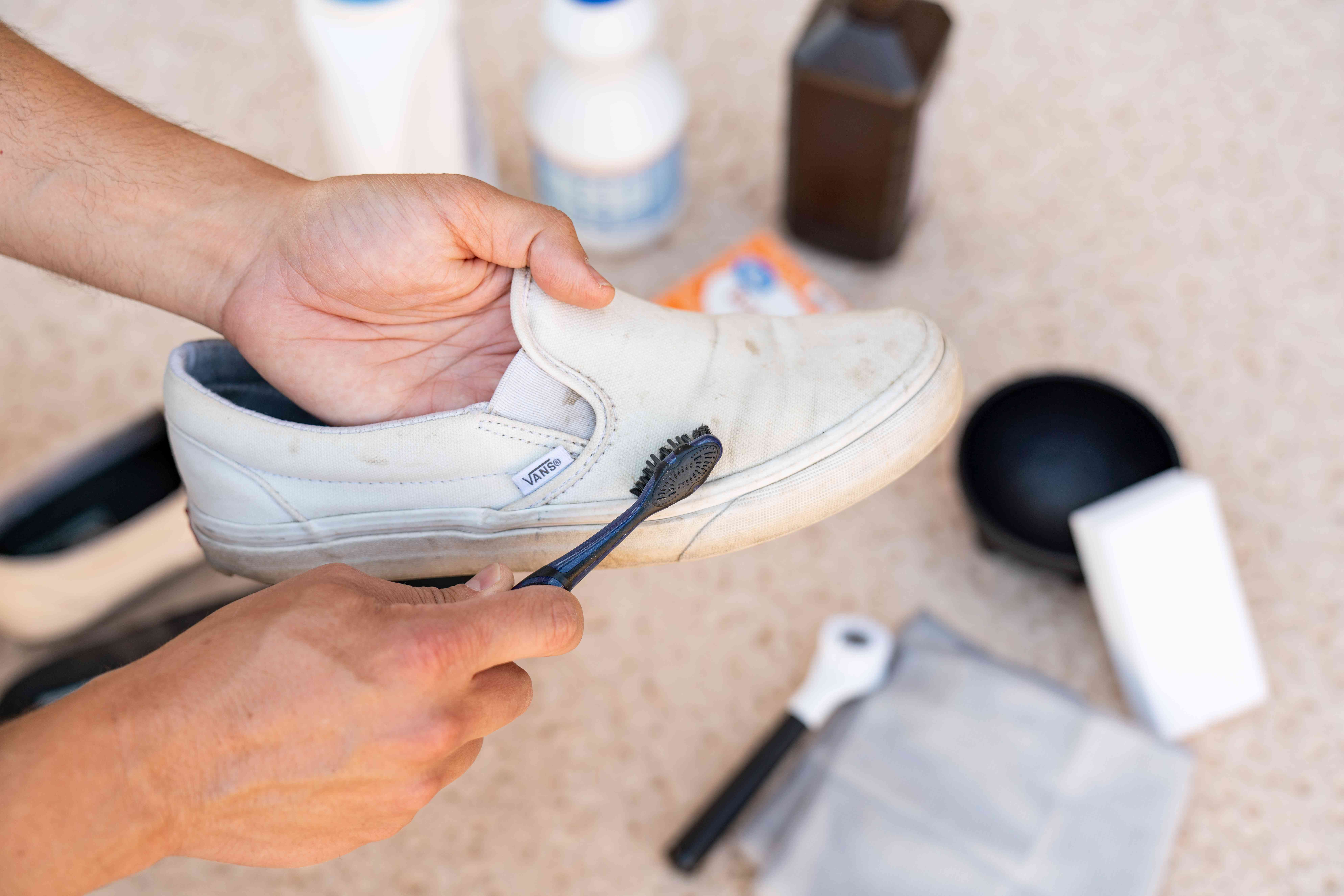 Dirty white vans fabric scrubbed by toothbrush to remove dust layer