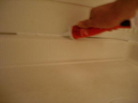 Caulking A Shower Stall Or Tub Surround - Applying caulk to shower