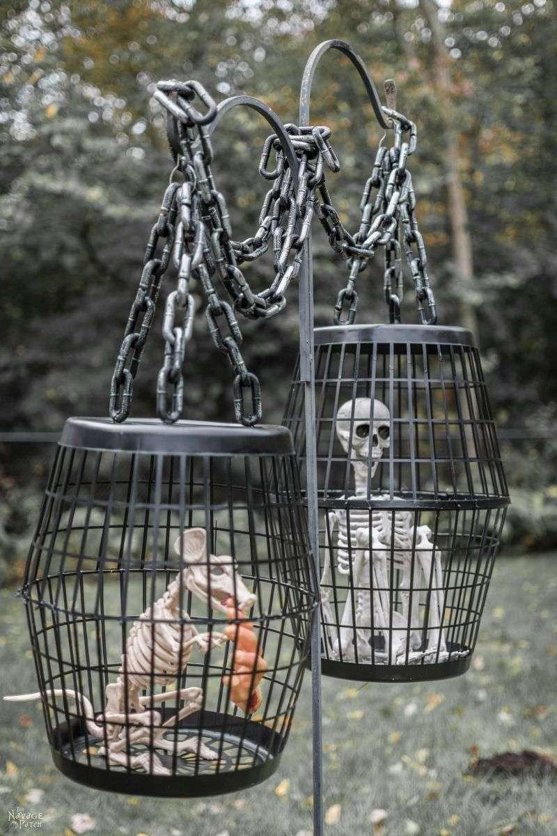 Black cages with skeletons inside