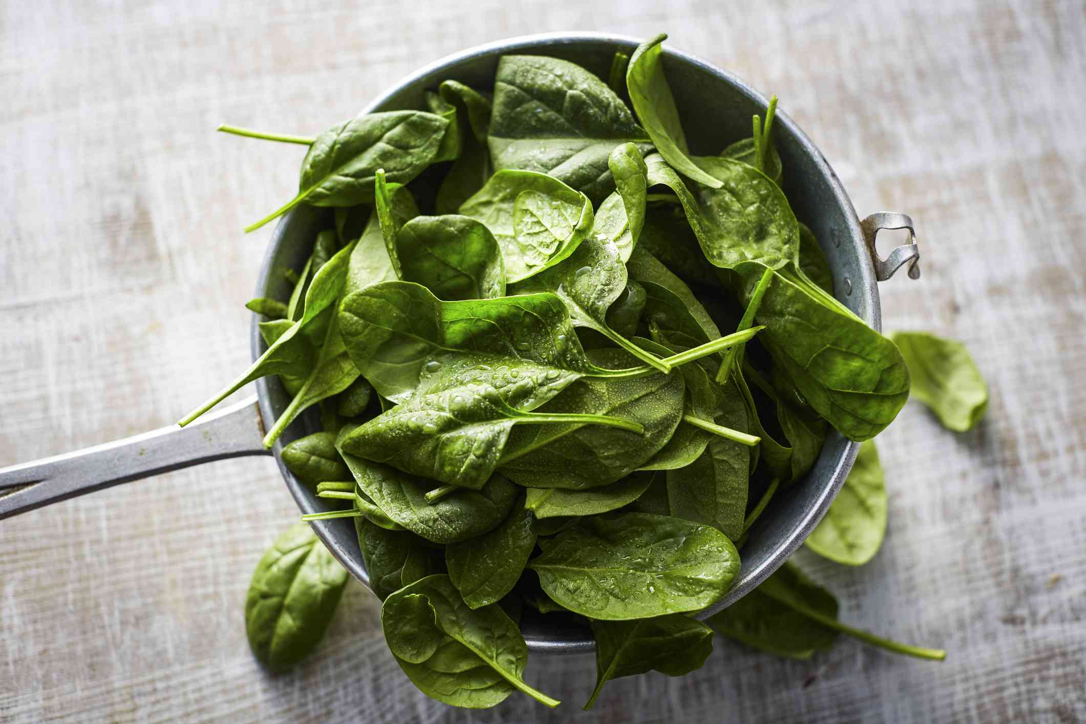 Fresh spinach in pot