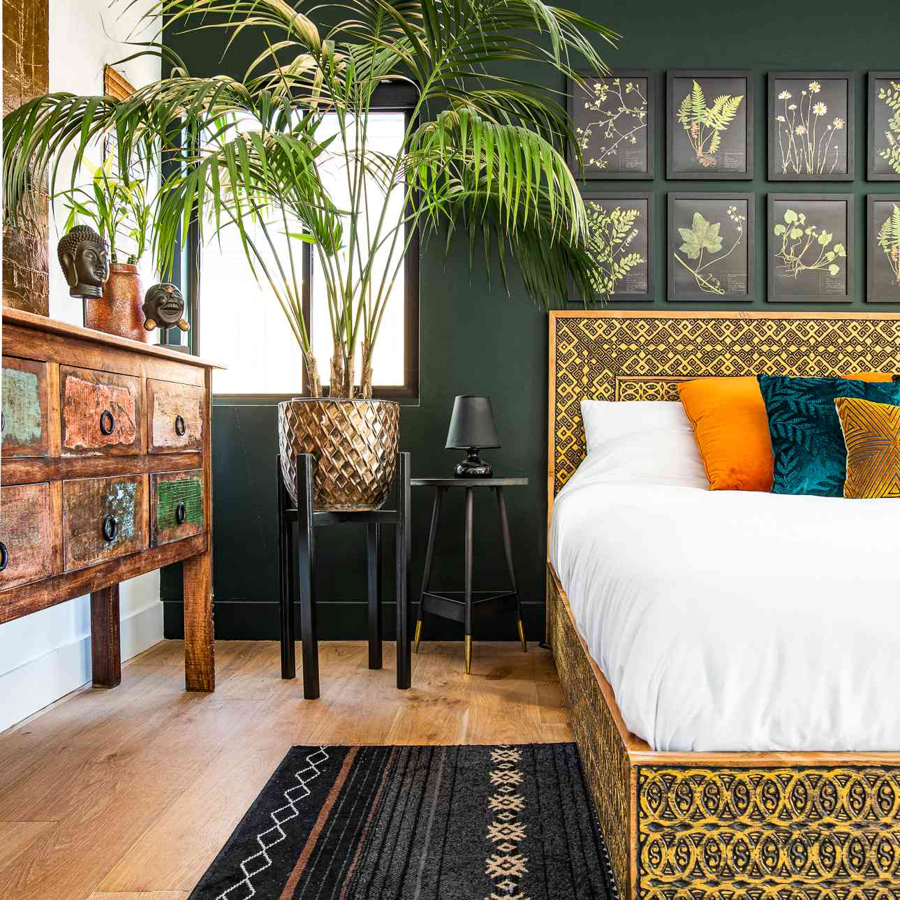 Boho bedroom with large plant