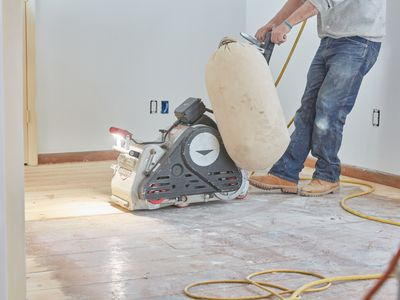 Sander machine passing over hardwood floors