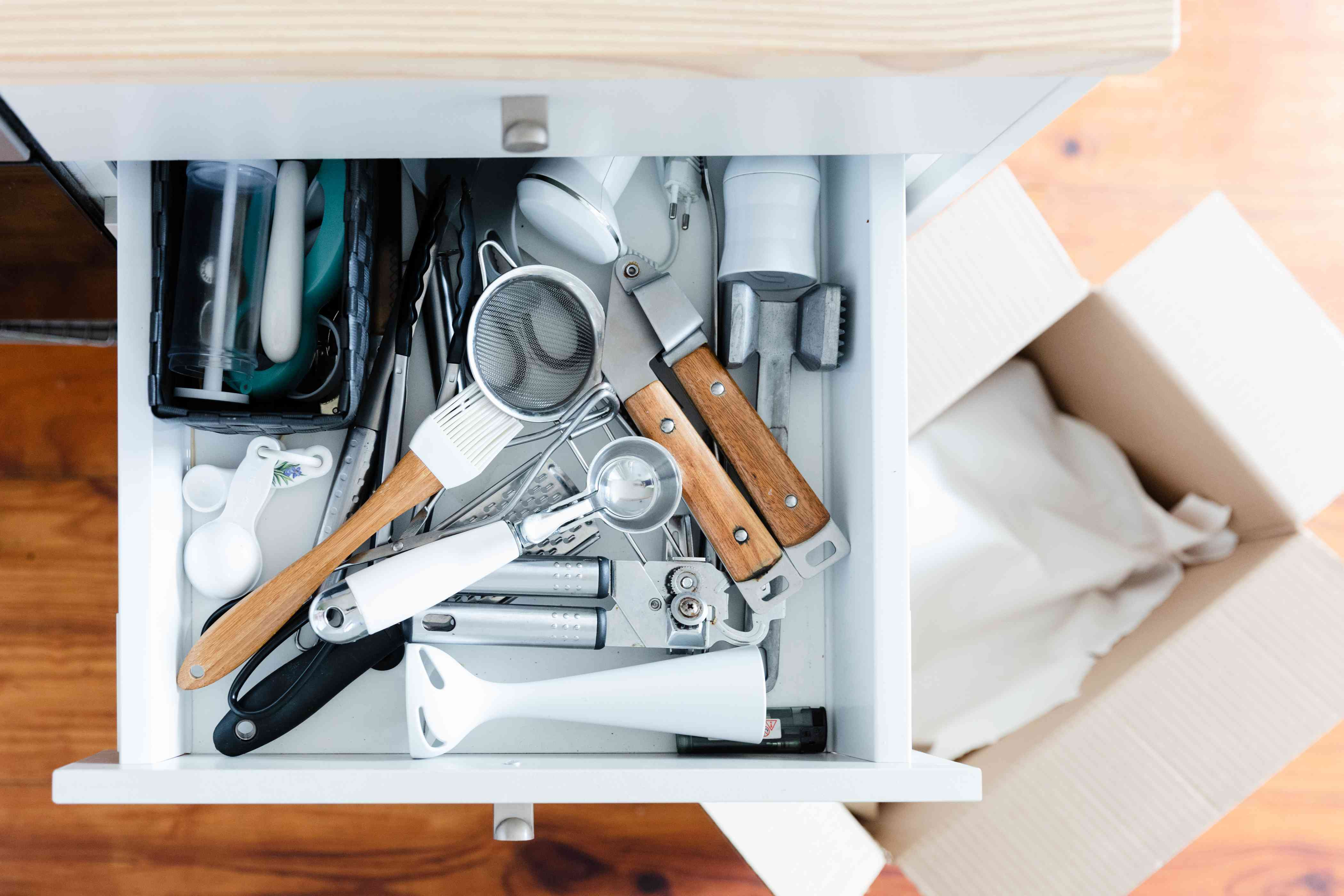 packing up the kitchen drawers
