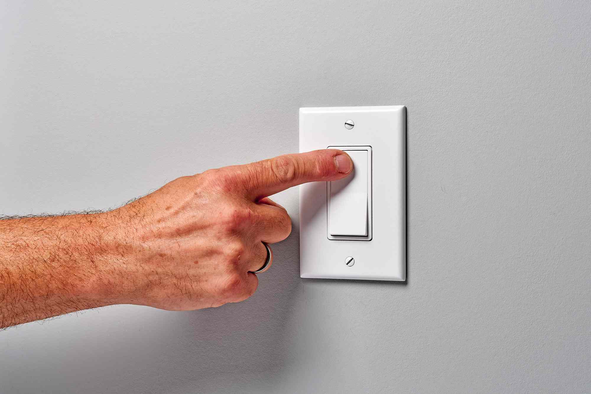 Light switch pressed and turned on to test the circuit