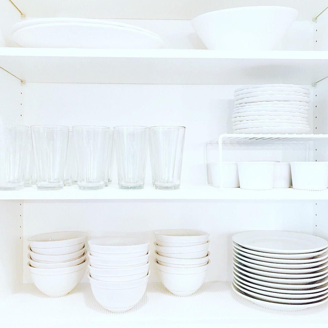 All white dishes on the shelf