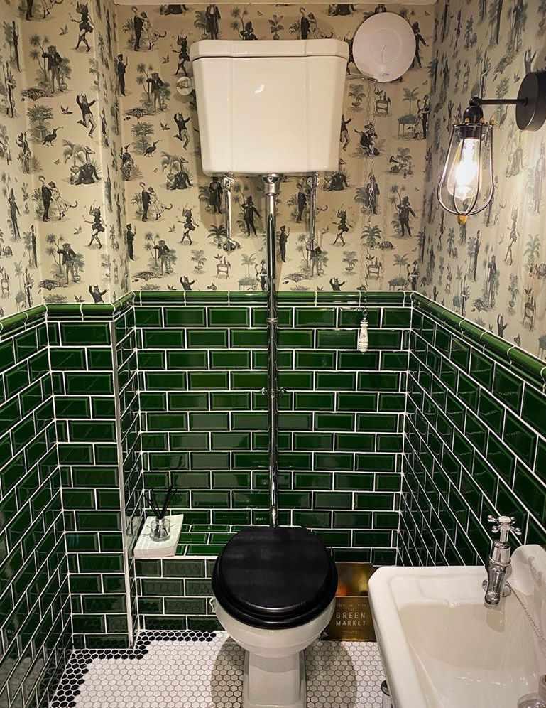 Bathroom with deep green tiles