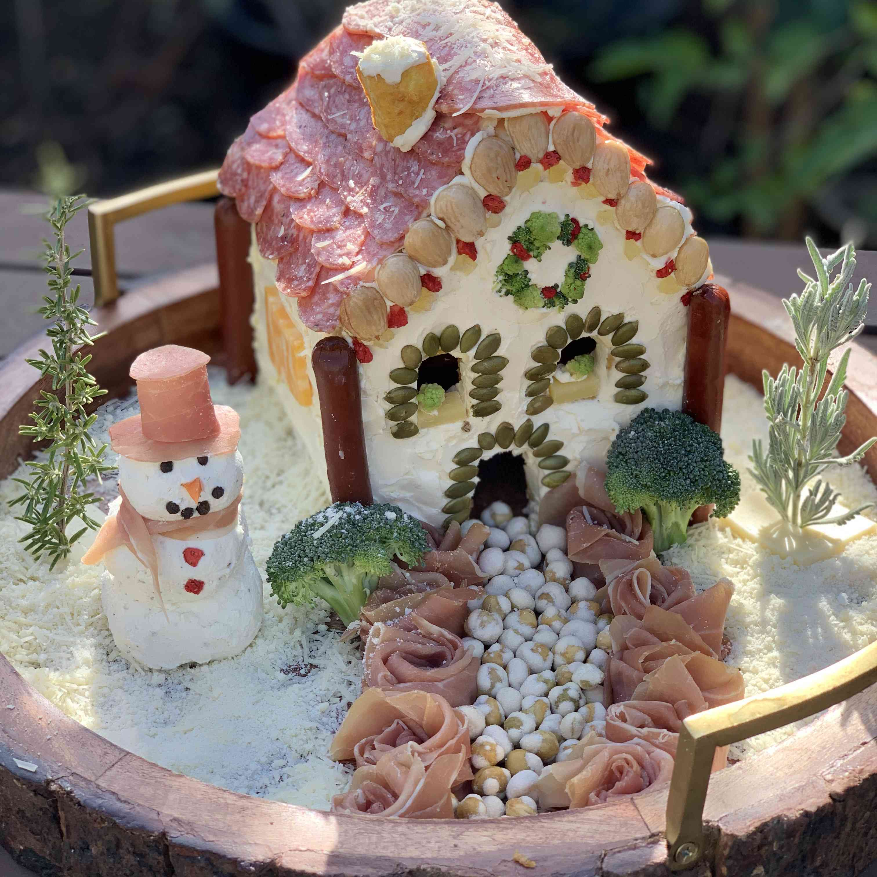 Frosty the Cheeseman charcuterie chalet