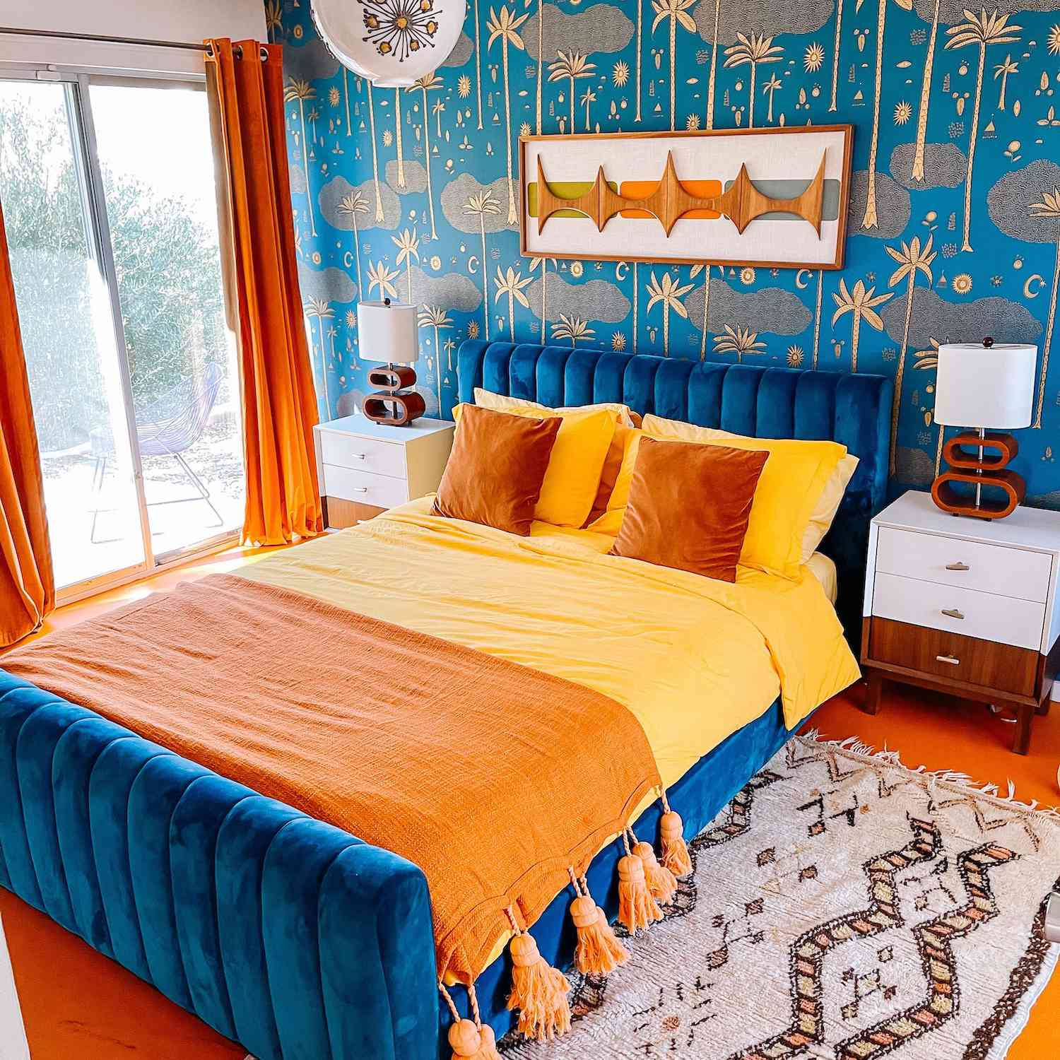 eclectic bedroom with orange, blue, and yellow color scheme