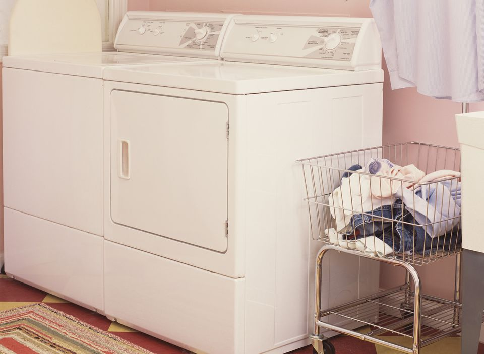 close up of washer dryer and clothes bin