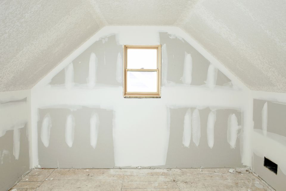 An attic with new drywall
