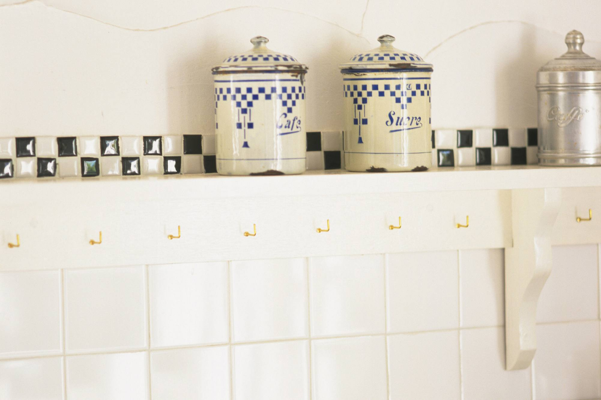 Vintage tiled kitchen walls with a contrasting checkerboard border.