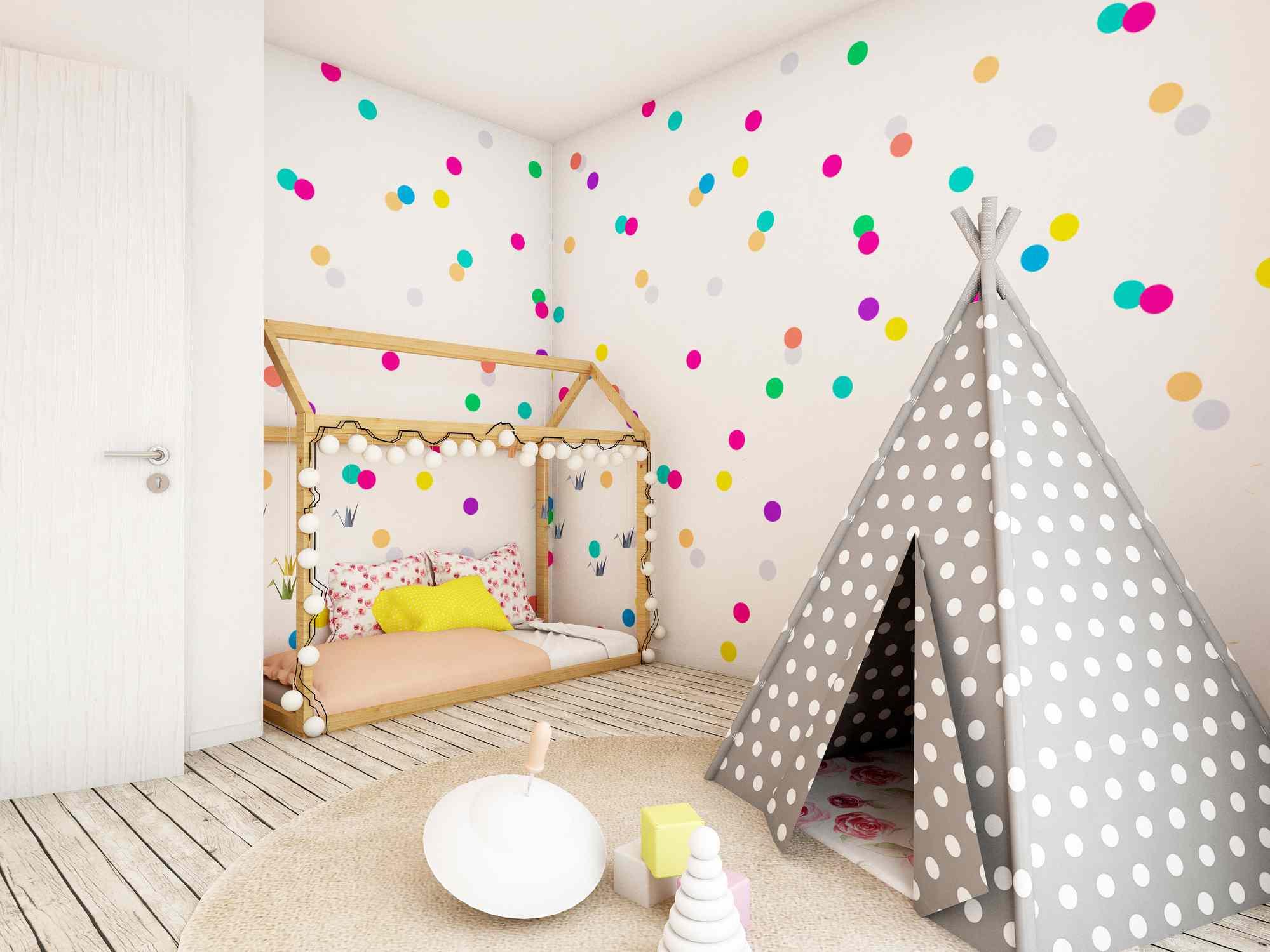 Bright polka dot wallpaper in a kids room.