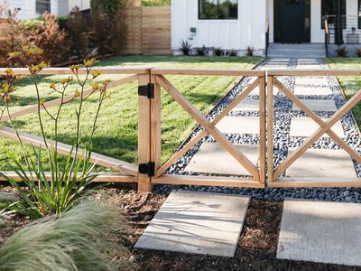 wooden x fence in a front yard