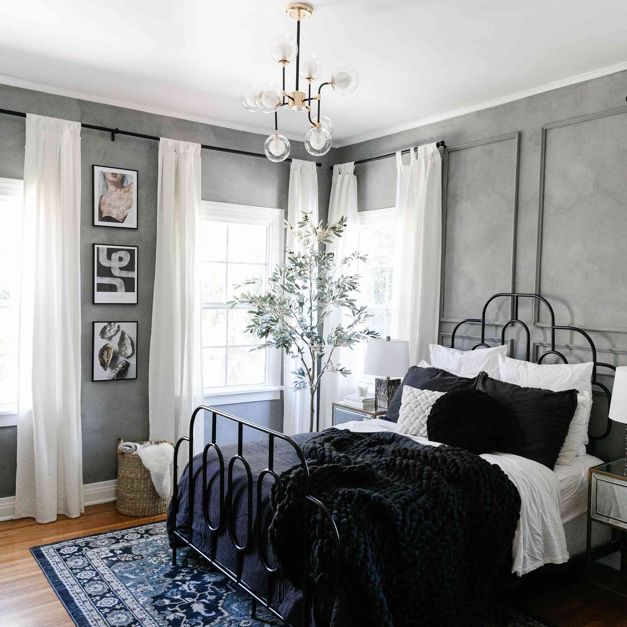 gray paint on the walls of the bedroom in drew scott's apartment