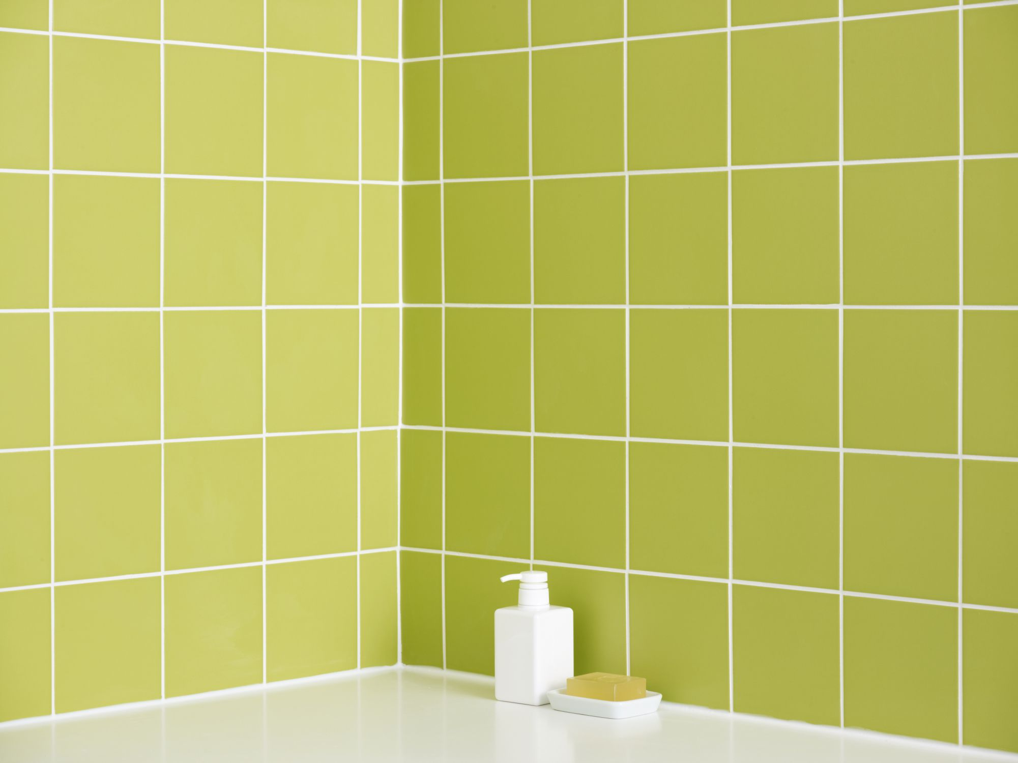 Green 4 by 4 Ceramic Tiles Near Bathtub