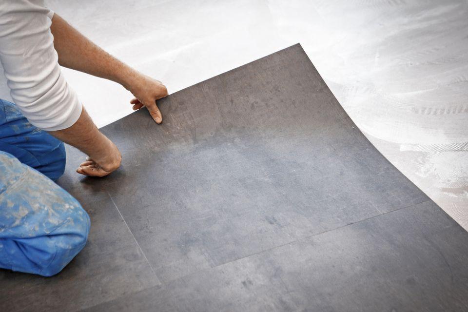 Man installing vinyl floor