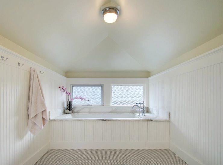 A minimalist beadboard bathroom
