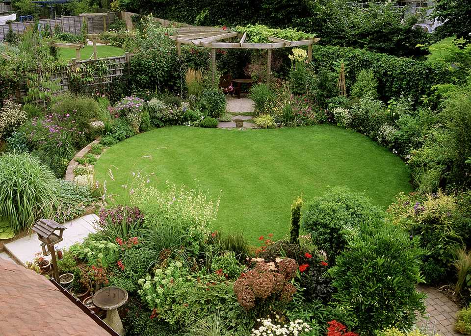 A beautiful, small lawn surrounded by bushes
