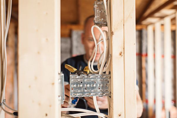 Electrician installing electricity, generating power in a home remodel
