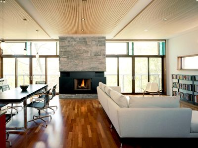 A modern living room with hypoallergenic upholstery and bare floors
