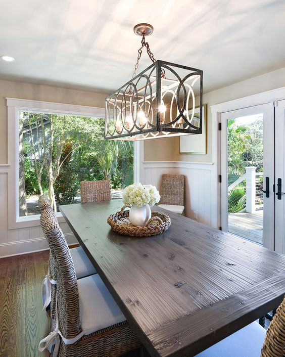 chandelier hanging over dining room table