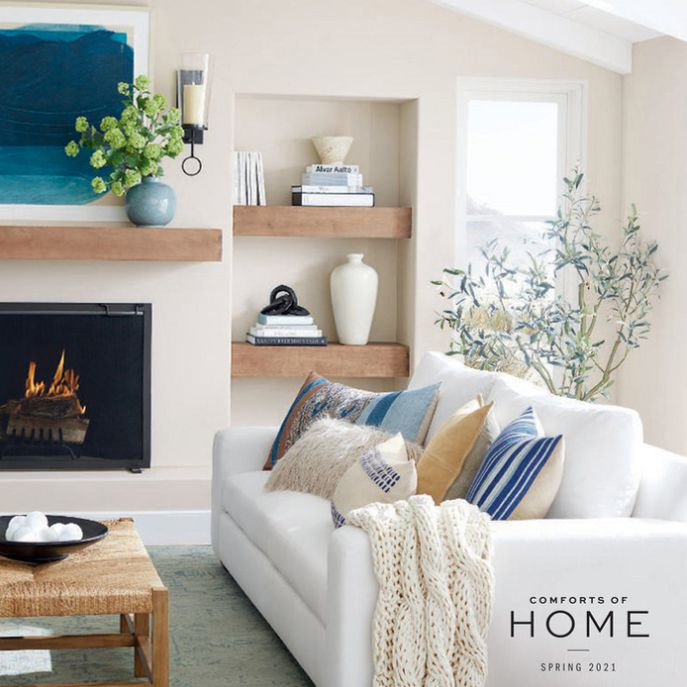 Cover of the 2021 Pottery Barn catalog featuring a living room with a white couch