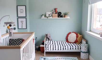 Simple Nordic nursery in aqua and red.