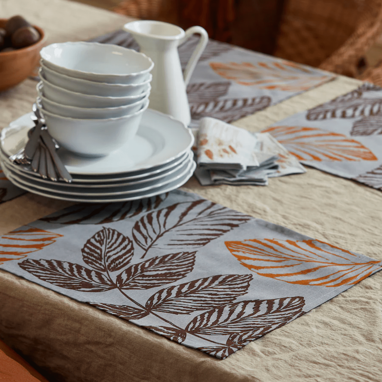 Leaf-printed placemats on a table