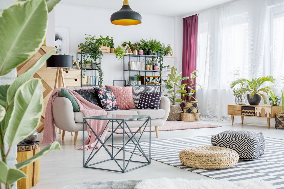 Spacious living room with pinks, whites, greens, browns, etc