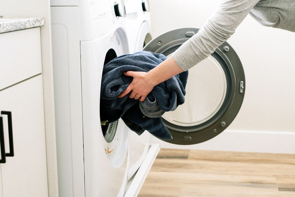 person loading a washer