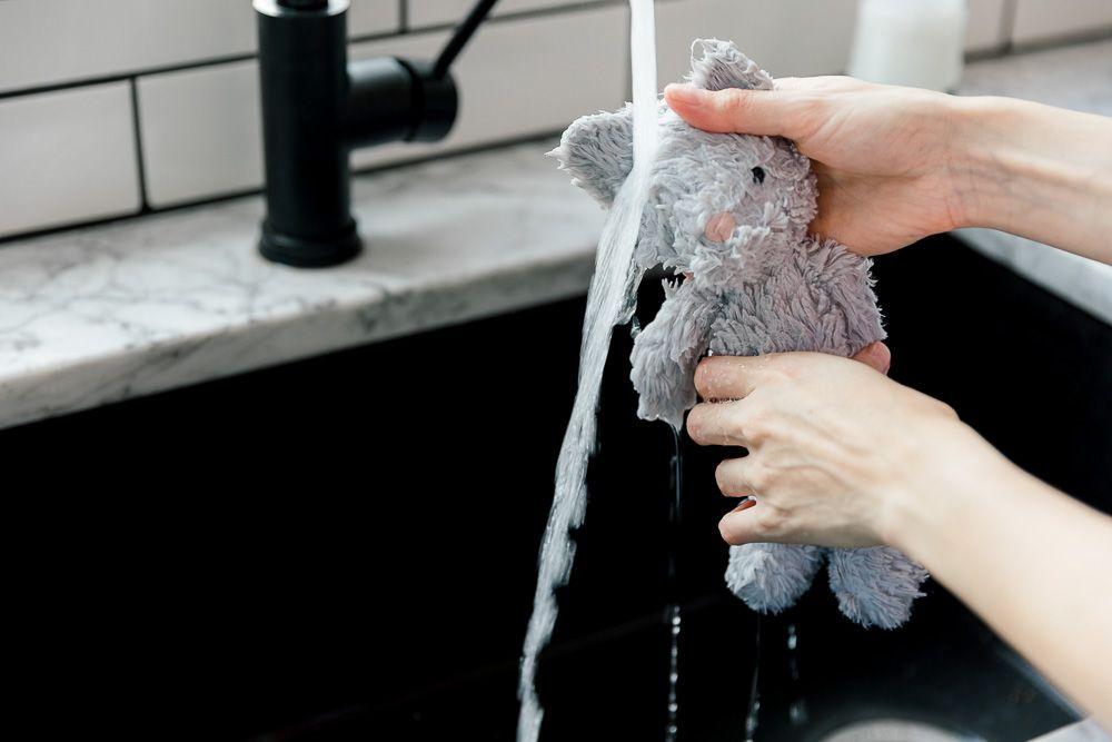 rinsing off a stuffed animal