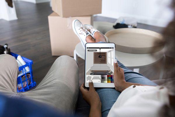 Couple examine home interior decorating idea