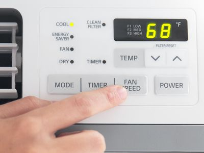 person changing fan speed on an air conditioner