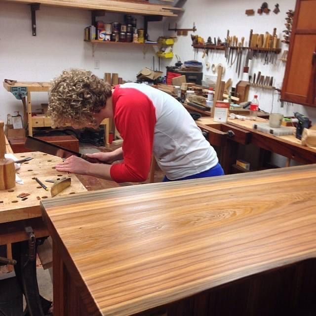 Katie making jewelry at her workbench