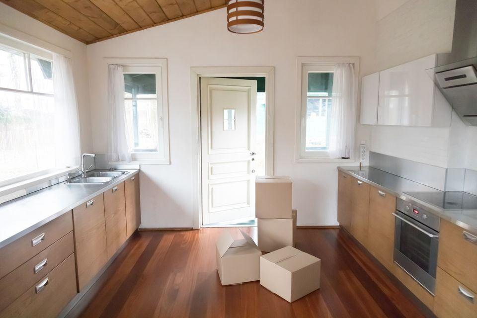 Cardboard boxes in new modern kitchen
